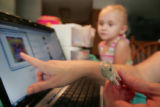 Shaleigh Whitesell (cq) checks her daughter's , Jessica,4, toys against a recall in their home...