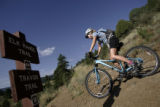 Rebecca Eckart (cq) of Golden, Colo., leaves the trail head at Centennial Cone Park in Golden,...
