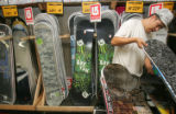 Shane Garcia (cq), 18, of Littleton, stacks snowboards in preparation for the Sniagrab sale at the...