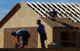 (CASTLE ROCK, Co., SHOT 9/17/2004) Construction workers Saul Galicia (left, with blue helmet) and...