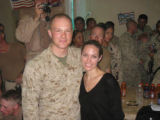 In this exclusive shot, Angelina Jolie poses with Denver native Lance Corporal Samuel Petersen,...