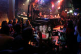 2460 Young people celebrate in a bar with dueling pianos called Willy D's in the River Market...