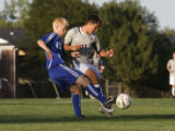 Cherry Ck's #19 Chris Podgorski battles Chatfield's Zack Foxhoven for control of the ball at...