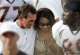 Rosalind Williams talks with Denver Broncos head coach Mike Shanahan after ending the practice...