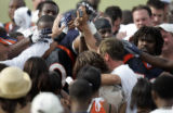 Rosalind Williams and Denver Broncos head coach Mike Shanahan help end the practice all saying...