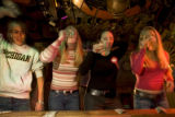 (BOULDER, Colo., Sep. 21, 2004)  (L-R) Chelsea Anker wins a beer drinking contest with contestants...