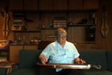 (GOLDEN Colo., September 22, 2004)  Ms. Greenberg in her home playing her dulcimer built by her...