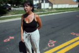Jeniffer Elder (cq) stands on East Kentucky Avenue at Waco Way in Aurora Friday August 17,2007....