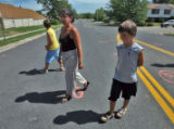Jennifer Elder (cq) stands on East Kentucky Avenue at Waco Way with her sons Logan Kelly...