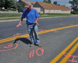 Duane Clark (cq) stands on East Kentucky Avenue at Waco Way in Aurora Friday August 17,2007....