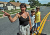 Jennifer Elder (cq) stands on East Kentucky Avenue at Waco Way with sons Brandon Kelly (cq) and...