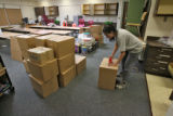 Art teacher Julie Weir (cq) packs up her class room at Del Pueblo Elementary School, Friday...
