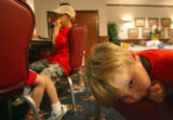 Christian Kruger, 4, of Colorado Springs, sits on a chair at Good Grief Camp at Fort Carson,...