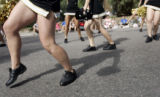 Members of the Monarch High School Poms dance their way down Main Street during the 72nd Annual...