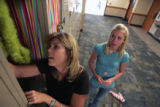 Mimi Humenik (cq) helps her daughter,Maggie Humenik (cq) , 15, a sophmore, decorate her locker at...