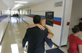 0194 Henry Middle School principal, Wendy Lanier, right, hugs, Jaime Aquino, chief academic...
