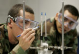 Freshman Air Force Cadets 4th class Kevin Horn  left,  and Adam Skula right, check specific heat...