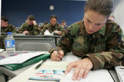 Freshman Air Force Cadets take a pop quiz in their Chemistry 100 class at the U. S. Air Force...