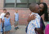 Takisha Ward (cq) gives a kiss to her son Xavier Williams (cq), 5, on the first day of...