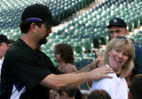 Carolyn Hammack (cq), gets Todd Helton to sign her tee shirt at Coors Field, Monday evening,...
