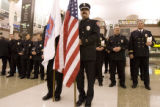 DM0522   John Alyward, center holding American flag, and other members of Littleton Fire and...