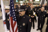 DM0562   John Alyward, center holding American flag, and other members of Littleton Fire and...