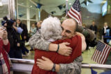 DM0604   Sgt. Jens Pietrzyk, 27, right, gets a hug from Julie Martin, 61, as he is greeted by...
