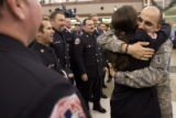 DM0690   Sgt. Jens Pietrzyk, 27, right, gets a hug from firefighter Erin Ortega as he is greeted...