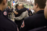 DM0726   Sgt. Jens Pietrzyk, 27, is greeted by dozens of his friends and coworkers from Littleton...