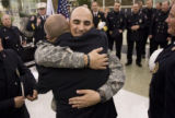 DM0764   Sgt. Jens Pietrzyk, 27, center facing camera, gets a hug from Capt. Tim Woodward as he is...