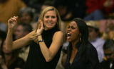 Ann Strother,left, cheers on the University of Colorado women from the bench at the Coors Events...