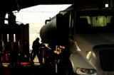 MJM080 Truck driver, Art Gray (cq) of DATS Trucking Inc. unhooks his tanker truck after filling it...