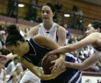 0365 5A/4A girls basketball- Broomfields' #21 Sophia Rhodes, center, fights off twin sisters for...