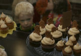 Joe Yoder, 3 gazes at the display of the tiny cakes of Happy Cakes at the new bakery in Denver,...