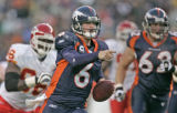 1126 Denver Broncos quarterback Jay Cutler makes a first down run after tripping on a linemans...