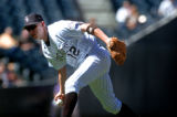 (DENVER, Co., SHOT 9/23/2004) The Colorado Rockies' Clint Barmes (#12) bare hands a ground ball in...
