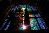 Michael Shields, Matthew Durbin and Philip Durbin, of Creative Stained Glass Studio of Evergreen,...