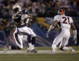 San Diego Chargers LaDainian Tomlinson spins for a first down against the Denvet Broncos in the...