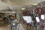 As many as twenty bullet holes riddle the entryway of the New Life church in Colorado SPrings,...
