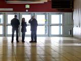 New Life Church by a security guard, Jeanne Assam, 42, center, stands in the hallway of the east...