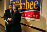 Republican presidential hopeful Mike Huckabee shakes hands with Jim Gilchrist, founder of the...