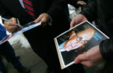 Republican Presidential candidate Rudy Giuliani, left, signs an autograph for Brian Dietrich (cq),...