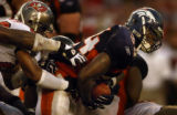 (Tampa, Fla., on Sun. Oct. 3, 2004)   Denver Broncos fullback Reuben Droughns scrambles through...