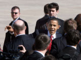 President Barack Obama waves after arriving  at Buckley Air Force Base in Aurora, Colo., on...
