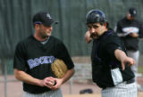 (1745) Pitcher Josh Fogg talks with Sal Fasano during Colorado Rockies spring training at Hi...