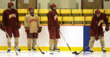 128 Anthony Maiani, second from left,  a sophomore forward for the University of Denver Hockey...