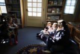 SR(090) At right, local book-enthusiasts, from left, Tori Oss, 5, and a 3-year-old Corinne...