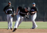 (0504) Clint Barmes fields a ground ball in front of Eric Young, left, and Omar Quintanilla,...
