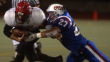 Denver,Colo., photo taken October 8, 2004- Cherry Creek's Willie Watters (#27 left) makes a huge...