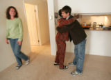 176  Drew Ryther, right, 16, gets a hug from Rubie Airington while his mother Karen Kantor, 38,...